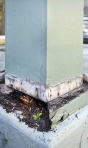 Termite damage around an exterior post.
